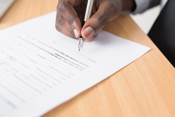 Person signing a separation agreement contract